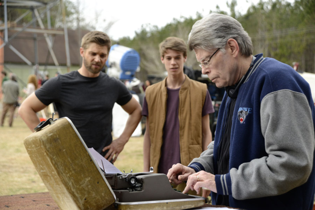 """(from left) """"Under the Dome"""" stars Mike Vogel and Colin Ford chat with author Stephen King on the first day of season two production Monday. — CBS photo"""
