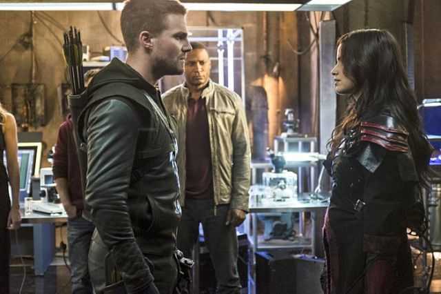 "Arrow -- ""The Magician"" Pictured (L-R): Stephen Amell as Oliver Queen, David Ramsey as John Diggle, and Katrina Law as Nyssa al Ghul -- Photo: Ed Araquel/The CW -- © 2014 The CW Network, LLC. All Rights Reserved."