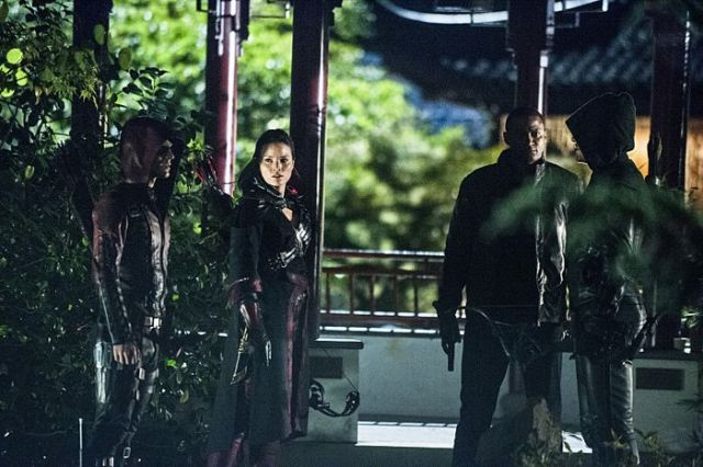 "Arrow -- ""The Magician"" Pictured (L-R): Colton Haynes as Arsenal, Katrina Law as Nyssa al Ghul, David Ramsey as John Diggle, and Stephen Amell as The Arrow -- Photo: Cate Cameron/The CW -- © 2014 The CWNetwork, LLC. All Rights Reserved."