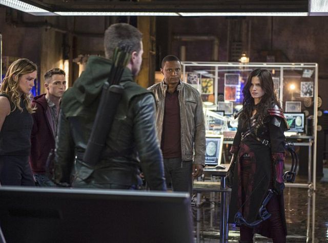 "Arrow -- ""The Magician"" Pictured (L-R): Katie Cassidy as Laurel Lance, Colton Haynes as Roy Harper, Stephen Amell as Oliver Queen, David Ramsey as John Diggle, and Katrina Law as Nyssa al Ghul -- Photo: Ed Araquel/The CW -- © 2014 The CW Network, LLC. All Rights Reserved."