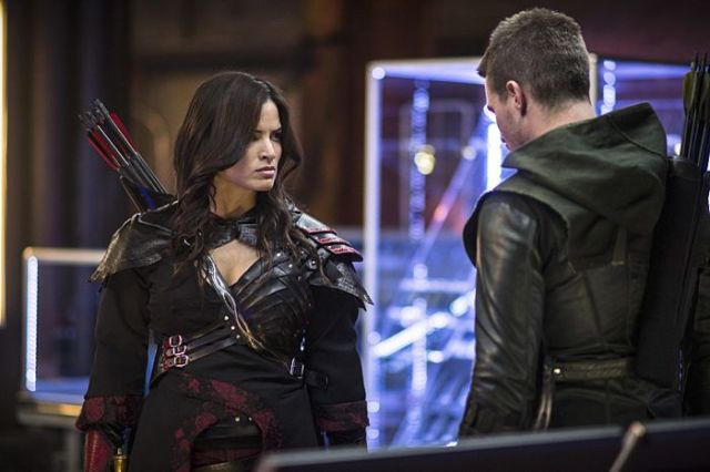 "Arrow -- ""The Magician"" Pictured (L-R): Katrina Law as Nyssa al Ghul and Stephen Amell as Oliver Queen -- Photo: Ed Araquel/The CW -- © 2014 The CW Network, LLC. All Rights Reserved."