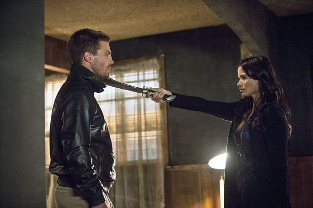 "Arrow -- ""The Magician"" Pictured (L-R): Stephen Amell as Oliver Queen and Katrina Law as Nyssa al Ghul -- Photo: Cate Cameron/The CW -- © 2014 The CW Network, LLC. All Rights Reserved."