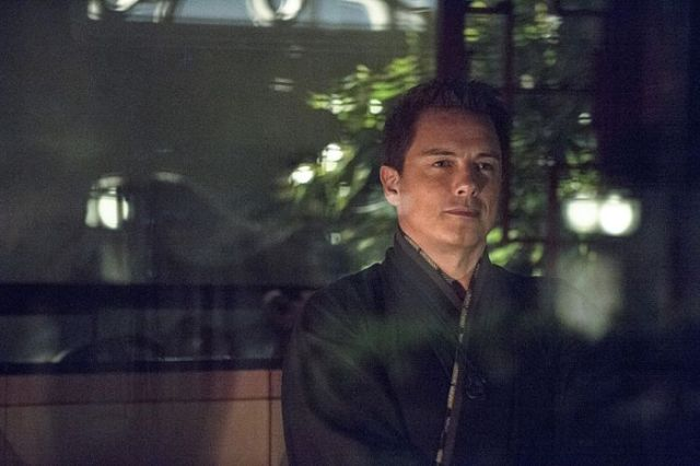 "Arrow -- ""The Magician"" Pictured: John Barrowman as Malcolm Merlyn -- Photo: Cate Cameron/The CW -- © 2014 The CW Network, LLC. All Rights Reserved."
