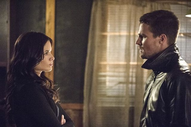 "Arrow -- ""The Magician"" Pictured (L-R): Katrina Law as Nyssa al Ghul and Stephen Amell as Oliver Queen -- Photo: Cate Cameron/The CW -- © 2014 The CW Network, LLC. All Rights Reserved."
