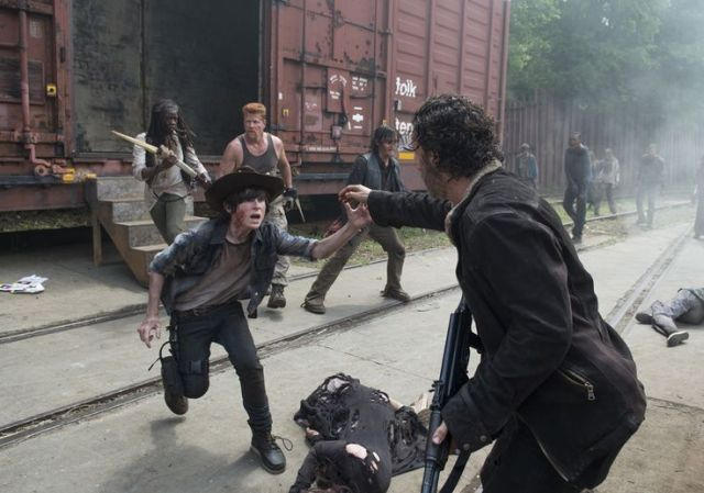 Carl Grimes (Chandler Riggs) and Rick Grimes (Andrew Lincoln) in Episode 1 Photo by Gene Page/AMC