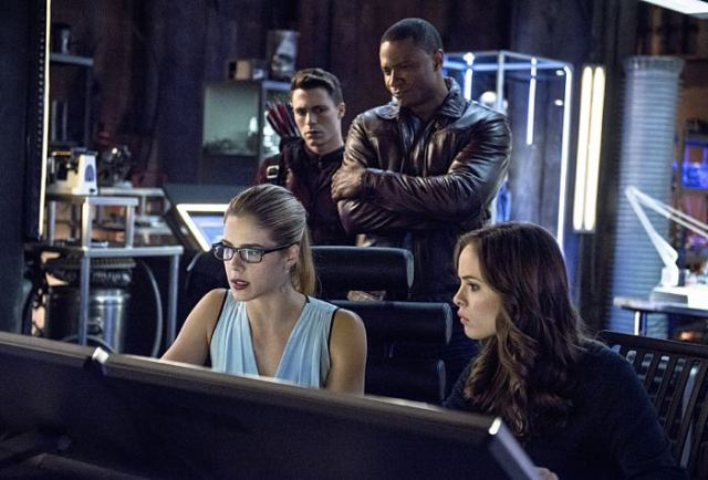 "Arrow -- ""The Brave and the Bold"" Pictured (L-R): Emily Bett Rickards as Felicity Smoak, Colton Haynes as Roy Harper / Arsenal, David Ramsey as John Diggle, and Danielle Panabaker as Caitlin Snow -- Photo: Cate Cameron/The CW -- © 2014 The CW Network, LLC. All Rights Reserved."