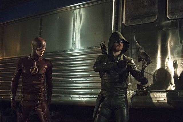"""Arrow -- """"The Brave and the Bold"""" Pictured (L-R): Grant Gustin as The Flash and Stephen Amell as The Arrow -- Photo: Cate Cameron/The CW -- © 2014 The CW Network, LLC. All Rights Reserved."""