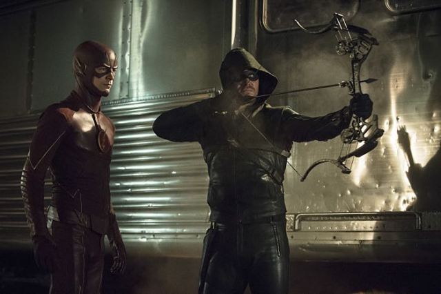 "Arrow -- ""The Brave and the Bold"" Pictured (L-R): Grant Gustin as The Flash and Stephen Amell as The Arrow -- Photo: Cate Cameron/The CW -- © 2014 The CW Network, LLC. All Rights Reserved."