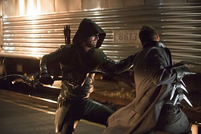 "Arrow -- ""The Brave and the Bold"" Pictured (L-R): Stephen Amell as The Arrow and Nick E. Tarabay as Digger Harkness -- Photo: Cate Cameron/The CW -- © 2014 The CW Network, LLC. All Rights Reserved."