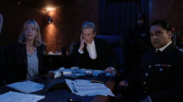 The Doctor - the new President of Earth, with Kate and Colonel Ahmed.
