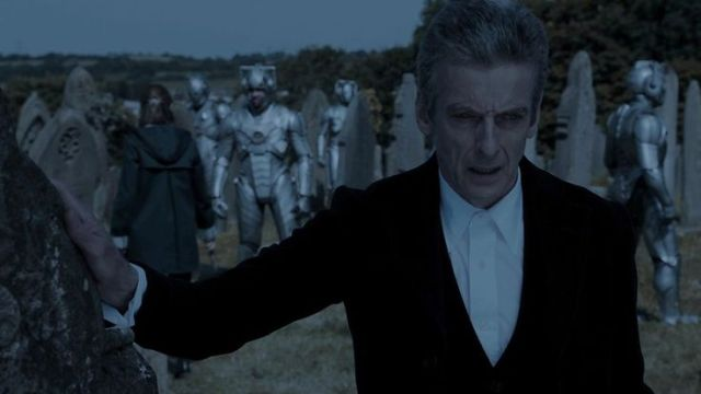 The Doctor turns away as Clara works…