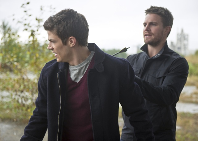 "The Flash -- ""Flash vs. Arrow"" Pictured (L-R): Grant Gustin as Barry Allen and Stephen Amell as Oliver Queen -- Photo: Diyah Pera/The CW -- © 2014 The CW Network, LLC. All rights reserved."