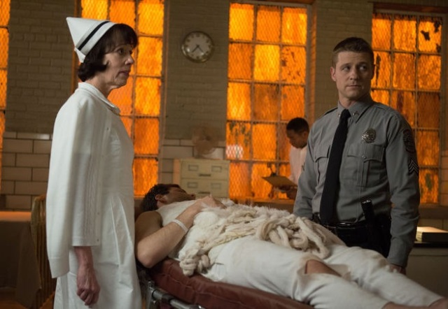 "GOTHAM: James Gordon (Ben McKenzie, R) accompanies a patient to the infirmary with Nurse Dorothy Duncan (guest star Allyce Beasley, L) in the ""Rogues' Gallery"" episode of GOTHAM airing Monday, Jan. 5 (8:00-9:00 PM ET/PT) on FOX. ©2014 Fox Broadcasting Co. Cr: Jessica Miglio/FOX"
