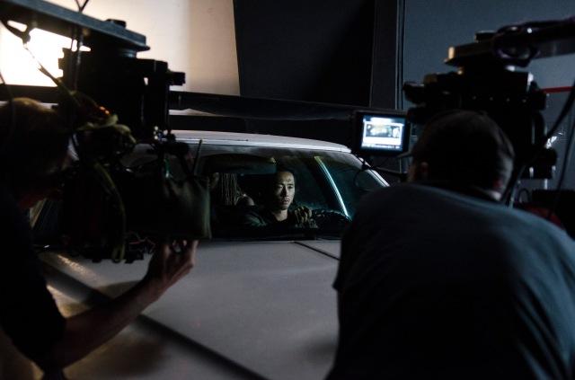 Steven Yeun - The Walking Dead _ Season 5, Episode 11 _ BTS - Photo Credit: Gene Page/AMC