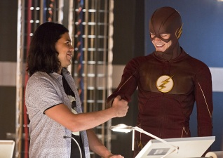 """The Flash -- """"Family of Rogues"""" -- Image FLA203a_0017b.jpg -- Pictured (L-R): Carlos Valdes as Cisco Ramon and Grant Gustin as The Flash -- Photo: Jeff Weddell/The CW -- © 2015 The CW Network, LLC. All rights reserved."""