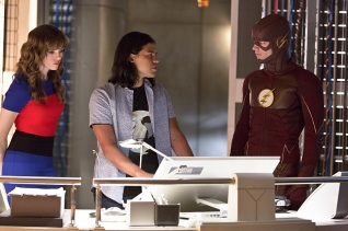 """The Flash -- """"Family of Rogues"""" -- Image FLA203a_0005b.jpg -- Pictured (L-R): Danielle Panabaker as Caitlin Snow, Carlos Valdes as Cisco Ramon and Grant Gustin as The Flash -- Photo: Jeff Weddell/The CW -- © 2015 The CW Network, LLC. All rights reserved."""