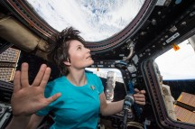 (February 28, 2015) --- Samantha Cristoforetti flashes the Vulcan Salute in the cupola of the space station in honor of the late Leonard Nimroy.