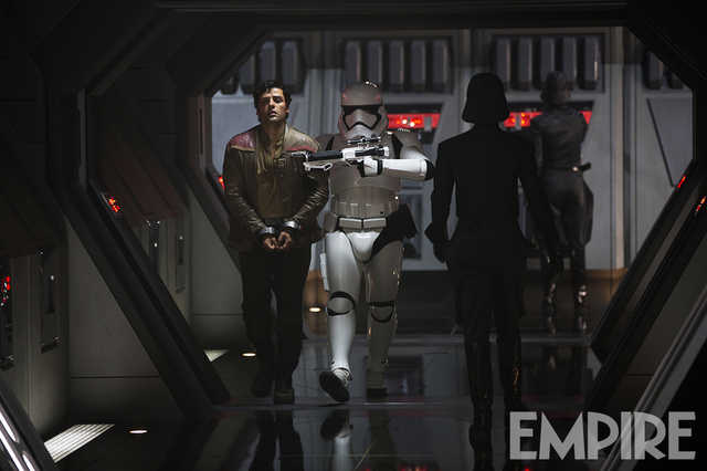 Star Wars: The Force Awakens Poe Dameron (Oscaar Isaac) and a First Order Trooper Ph: David James © 2015 Lucasfilm Ltd. & TM. All Right Reserved..