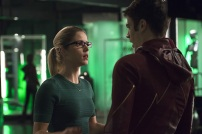 """The Flash -- """"Legends of Today"""" -- Image FLA208B_0078b2.jpg -- Pictured (L-R): Emily Bett Rickards as Felicity Smoak and Grant Gustin as Barry Allen -- Photo: Cate Cameron /The CW -- © 2015 The CW Network, LLC. All rights reserved."""