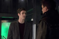 """The Flash -- """"Legends of Today"""" -- Image FLA208B_0140b.jpg -- Pictured (L-R): Grant Gustin as Barry Allen and John Barrowman as Malcolm Merlyn -- Photo: Cate Cameron /The CW -- © 2015 The CW Network, LLC. All rights reserved."""