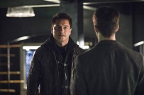 """The Flash -- """"Legends of Today"""" -- Image FLA208B_0199b.jpg -- Pictured (L-R): John Barrowman as Malcolm Merlyn and Grant Gustin as Barry Allen -- Photo: Cate Cameron/The CW -- © 2015 The CW Network, LLC. All rights reserved"""