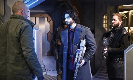 """DC's Legends of Tomorrow -- """"Marooned"""" -- Image LGN107B_0216b.jpg -- Pictured (L-R): Dominic Purcell as Mick Rory / Heat Wave and Aatash Amir as Lieutenant Drake -- Photo: Bettina Strauss/The CW -- © 2016 The CW Network, LLC. All Rights Reserved."""