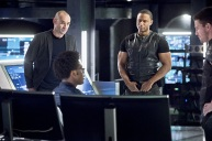 "Arrow -- ""Beacon of Hope"" -- Image AR417a_0034b.jpg -- Pictured (L-R): Paul Blackthorne as Detective Quentin Lance, Echo Kellum as Curtis Holt, David Ramsey as John Diggle and Stephen Amell as Oliver Queen -- Photo: Dean Buscher/The CW -- © 2016 The CW Network, LLC. All Rights Reserved."