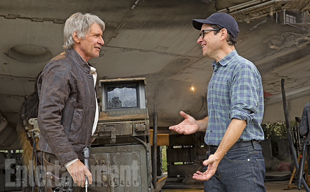 """""""You never go into a day of shooting and say, 'This is probably going to be on the cutting room floor,'"""" says Abrams, seen here in a newly released behind-the-scenes shot with Harrison Ford. """"Every day feels as essential as anything else. It's always annoying to realize that you wasted anyone's time on shooting something that wasn't necessary."""" Most of the deleted scenes from The Force Awakens don't radically change the story, but each deepens the characters in some way. Here are details on some more..."""