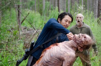 Steven Yeun as Glenn Rhee and Walkers- The Walking Dead _ Season 6, Episode 12 - Photo Credit: Gene Page/AMC