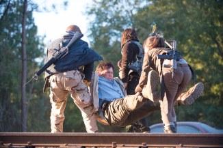 Michael Cudlitz as Abraham, Josh McDermitt as Dr. Eugene Porter, Norman Reedus as Daryl Dixon, and Christian Serratos as Rosita Espinosa - The Walking Dead _ Season 6, Episode 14 - Photo Credit: Gene Page/AMC