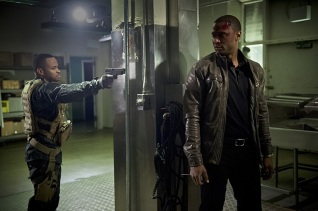 """Arrow -- """" Genesis"""" -- Image AR420a_0319b.jpg -- Pictured (L-R): Eugene Byrd as Andy Diggle and David Ramsey as John Diggle -- Photo: Diyah Pera/The CW -- © 2016 The CW Network, LLC. All Rights Reserved."""