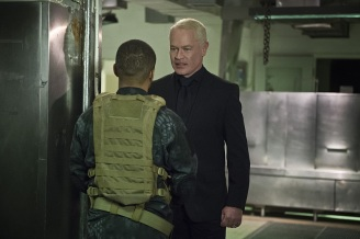 "Arrow -- ""Genesis"" -- Image AR420a_0407b.jpg -- Pictured (L-R): Eugene Byrd as Andy Diggle and Neal McDonough as Damien Darhk -- Photo: Diyah Pera/The CW -- © 2016 The CW Network, LLC. All Rights Reserved."