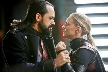 "DC's Legends of Tomorrow -- ""Leviathan""-- Image LGN113b_0056b.jpg -- Pictured (L-R): Casper Crump as Vandal Savage and Jessica Sipos as Cassandra -- Photo: Bettina Strauss/The CW -- © 2016 The CW Network, LLC. All Rights Reserved."