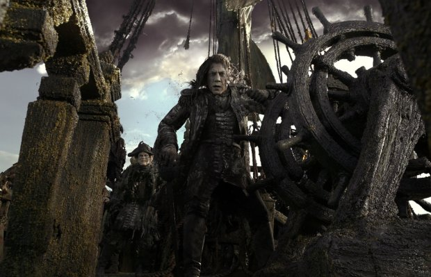 """PIRATES OF THE CARIBBEAN: DEAD MEN TELL NO TALES"" The villainous Captain Salazar (Javier Bardem) pursues Jack Sparrow (Johnny Depp) as he searches for the trident used by Poseidon. ©Disney Enterprises, Inc. All Rights Reserved."