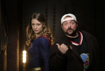 """Supergirl -- """"Supergirl Lives"""" -- Image SPG209a_BTS_0562.jpg -- Pictured: (L-R) Melissa Benoist as Kara/Supergirl and Kevin Smith -- Photo: Robert Falconer/The CW -- © 2017 The CW Network, LLC. All Rights Reserved"""