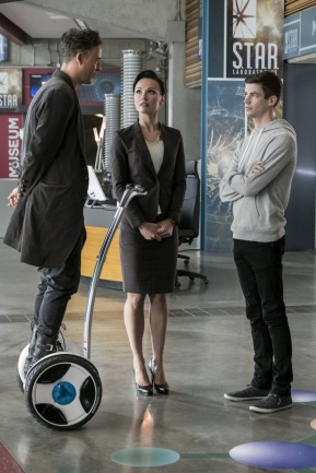 "The Flash -- ""Borrowing Problems from the Future"" -- Image FLA310b_0077b.jpg -- Pictured (L-R): Tom Cavanagh as Harrison Wells, Lindsay Maxwell as Olga and Grant Gustin as Barry Allen -- Photo: Katie Yu/The CW -- © 2016 The CW Network, LLC. All rights reserved."